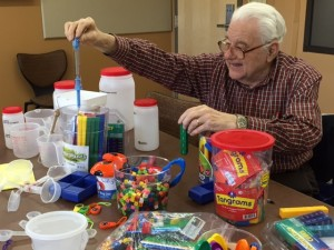 RSVP volunteer holding science experiment supplies