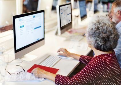 Elderly woman using desktop